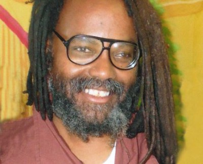 Mumia Abu-Jamal, shown in a 2013 photo, a college educated professional journalist, has continued to write news and commentary throughout his 30 years of imprisonment – an excellent role model for the disciplined scholarship expected of students.