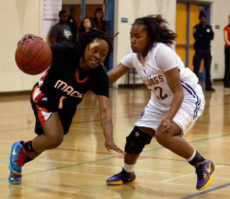 Gabby Gaines goes hard to the hold in a Mack (McClymonds) game. The girls took the team, known for decades as a loser, to champions of the Oakland Athletic League, the first McClymonds championship since 1976.