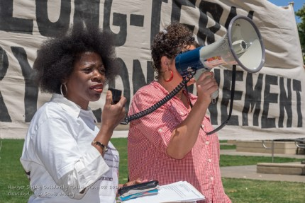 At a noontime rally marking the first anniversary of last year's largest-ever hunger strike, held in Oakland on July 8 at Oscar Grant Plaza, Marie Levin speaks out about her love for her brother, Sitawa Nantambu Jamaa (Ronnie Dewberry), one of the four main prisoner representatives who called the three hunger strikes, beginning in 2011.