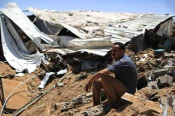 A Palestinian man sits among the ruins of his farm in Gaza City after it was targeted by an Israeli airstrike. – Photo: Mohammed Omer