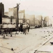 The people of Black Wall Street, the Greenwood District of Tulsa, look around at the devastation of the entire 1 square mile neighborhood after the smoke cleared. Many of their neighbors had died; estimates range from 300 to 3,000, proponents of the larger number citing stories of a mass grave. – Photo: Tulsa Historical Society