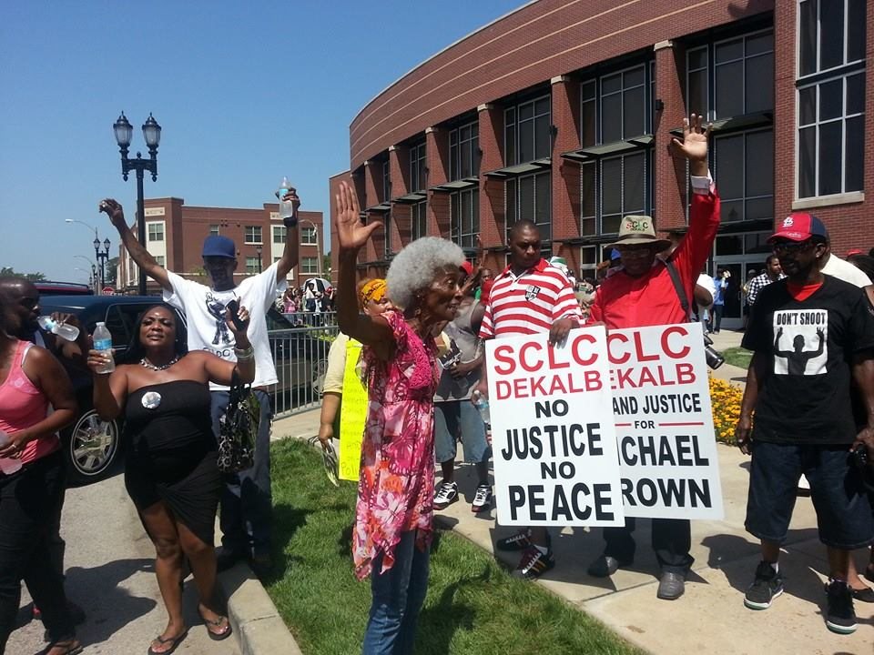 This elder came to Mike Brown's funeral on Aug. 25 to demonstrate to the corporate media that the Black community in St. Louis supports the youth, who demand justice and demand to be seen as human beings. She and many others had to stay outside the church, which was filled to capacity with 4,500 mourners. Inside, speaker after speaker emphasized the humanity, the dignity of Michael Brown and all Black people seen by police as targets. – Photo: JR Valrey, Block Report