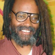 "World famous commentator and political prisoner Mumia Abu-Jamal gave the commencement speech Oct. 5 at Goddard College, where he earned his degree, at the invitation of the students and with the backing of the administration, which had to move the ceremony forward three hours to avoid threatened disruption from police who have long sought to silence Mumia. Immediately, Philadelphia's Fraternal Order of Police pressured the state Legislature for this Victim Revictimization Relief Act, enabling victims to sue to stop a prisoner from causing them mental anguish, thus silencing Mumia and other state prisoners. ""Unconstitutional Tom"" Corbett, Pennsylvania's very unpopular governor, urged legislators to pass the bill. They did and he signed it on Oct. 21. Prison censorship has hit a new low!"