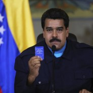 Venezuela President Nicolas Maduro holds a copy of the Venezuelan Constitution as he speaks to his people. – Photo: Reuters