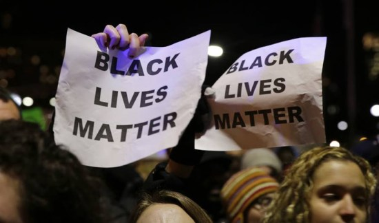 """Black Lives Matter"" signs in Ferguson"