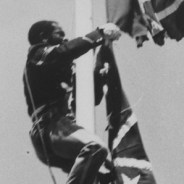 Richard Bradley, dressed in a Union soldier's uniform, cuts down the Confederate flag from atop the 50-foot pole in the San Francisco Civic Center, April 15, 1984.
