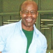 Bomani Shakur (Keith LaMar), shackled, smiling cropped
