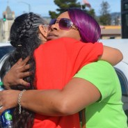 The Oscar Grant Legacy Weekend was all about unity. Mothers of police victims from all over the country came together in mutual support, forming strong friendships. Here, Leslie McSpadden, mother of Michael Brown from Ferguson, Missouri, hugs Theresa Smith, mother Caesar Cruz from Anaheim, Calif. – Photo: Love Not Blood Campaign