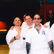 """Organizing to End Prison Slavery in Texas at the Coffield Unit are David """"Chino"""" Martinez, far left, Keith """"Malik"""" Washington in front and other comrades."""
