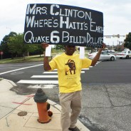At the Democratic National Convention, held in the Wells Fargo Center, an arena miles from City Hall, where most of the protests had to be held, Haitians managed to bring their signs close to the convention hall. This sign refers to the missing billions in earthquake relief, much of it having found its way into the pockets of the Clintons and their relatives and friends. – Photo: Komokoda