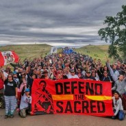 One day after the people of Standing Rock filed for an injunction to prevent destruction of a major burial site they had just identified, the pipeline contractor sent a crew out before dawn on Saturday, Sept. 3, and bulldozed the site, destroying ancient cairns and stone prayer rings. As they do every morning – not taking the Labor Day weekend off – the people of Standing Rock and their allies from five dozen Native tribes marched to the construction site only to discover the destruction. A security firm hired by the contractor met them with attack dogs, and the scene reminded the watching world of dog attacks on civil rights protesters.