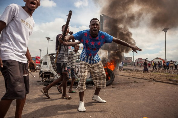 During an opposition rally in Kinshasa on Sept. 19, Congolese protest President Kabila's decision to delay elections, furious at his attempt to cling to power. – Photo: Eduardo Soteras, AFP