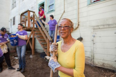 Longtime Bayview homeowner Alfreda Furgensen poses with Habitat for Humanity Greater San Francisco volunteers who cleared out massive blackberry bushes that took over her entire backyard.