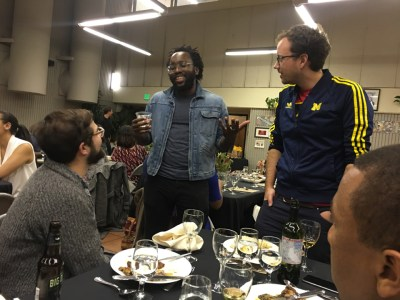 Chef Tunde Wey (center) talks with diners.