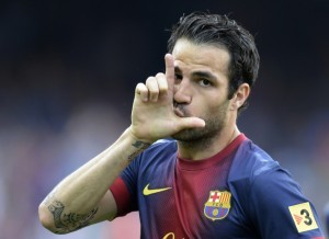 Barcelona's midfielder Cesc Fabregas celebrates after scoring a goal during the Spanish league football match FC Barcelona vs Malaga CF at the Camp Nou stadium in Barcelona on June 1, 2013. AFP PHOTO / LLUIS GENE (Photo credit should read LLUIS GENE/AFP/Getty Images)