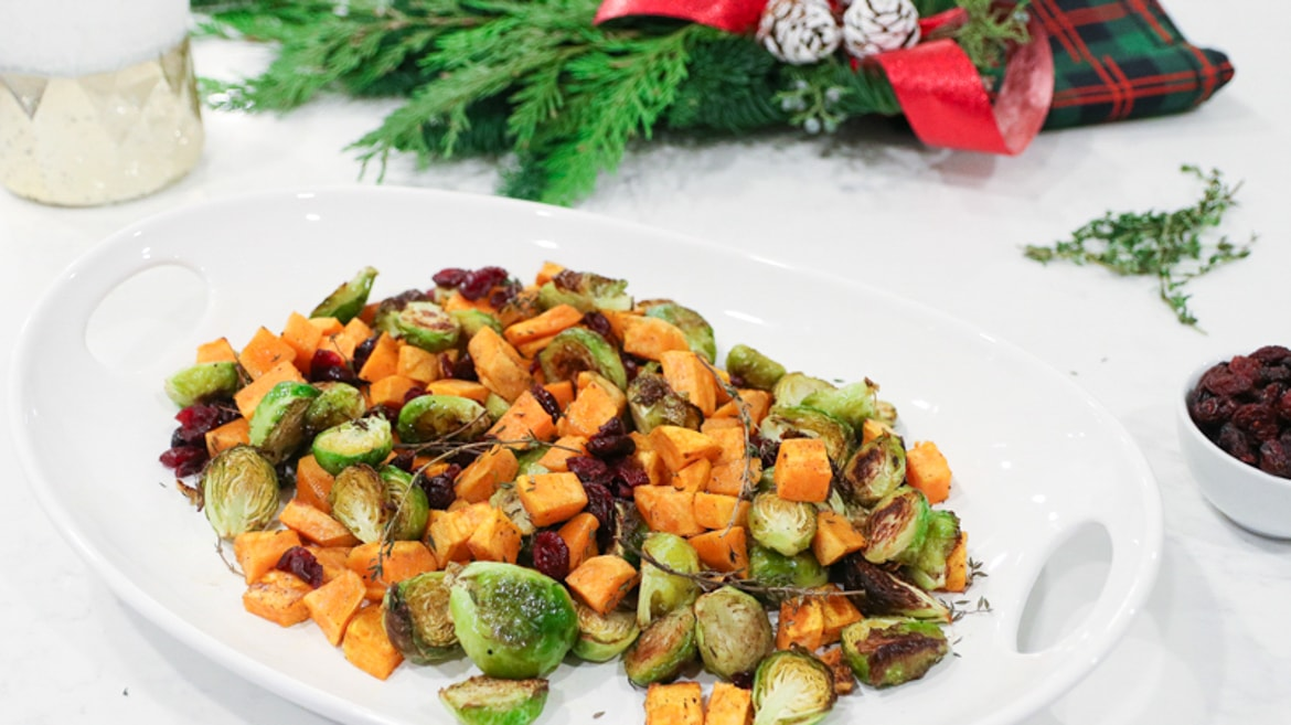 tray of roasted Brussels sprouts with sweet potatoes and dried cranberries