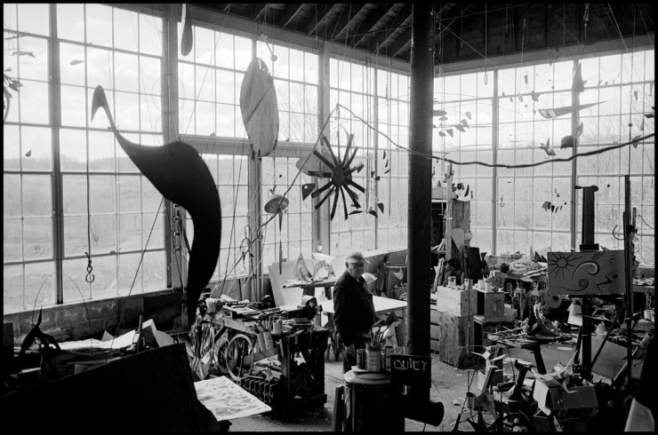 The inventor of the sculpture 'mobile' photographed at his studio..