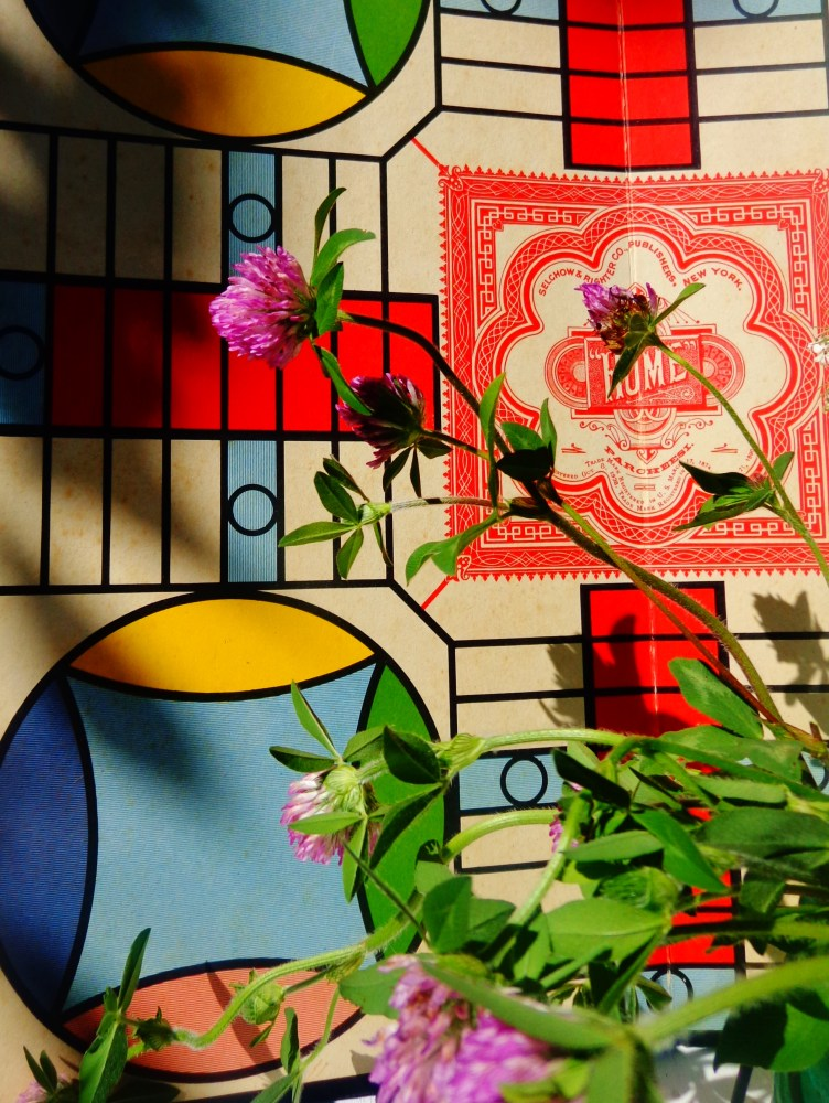 parcheesi board with flowers in front on Shalavee.com