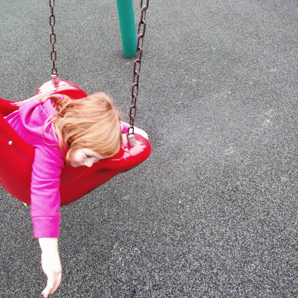 Fioan in the swing at the playground on Shalavee.com