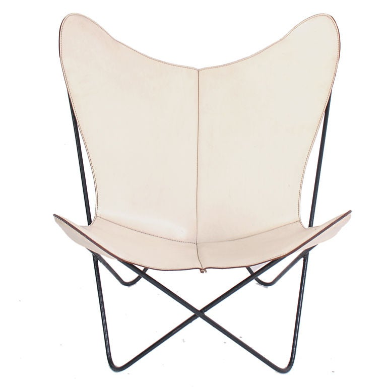 Sculptural butterfly chair in original white leather at