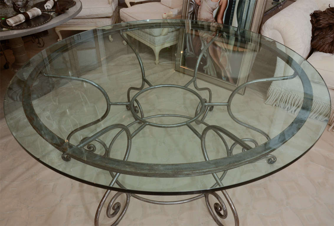kitchen table sets glass top glass kitchen tables Kitchen Table Sets Glass Top Round Glass Top Dining Table with Attractive Wrought Iron Base image 3 R Round Glass Top Dining Table