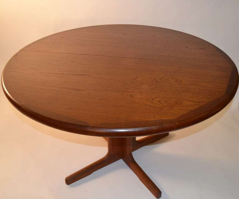 Round teak danish modern dining table with two leaves at 1stdibs