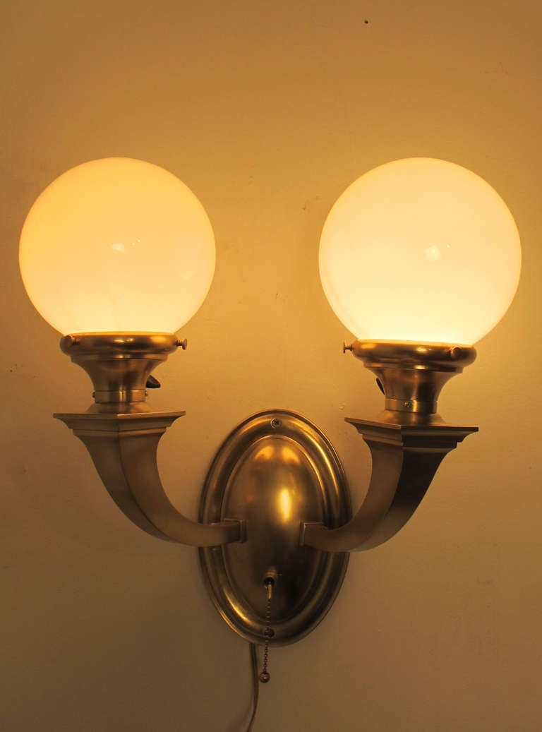 Pair Of Brass Double Globe Wall Sconces At 1stdibs