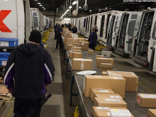 Go behind the scenes as UPS, FedEx race to deliver in time for - material handler fedex