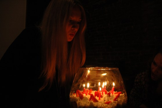 Jennifer blowing birthday candles out on strawberry trifle