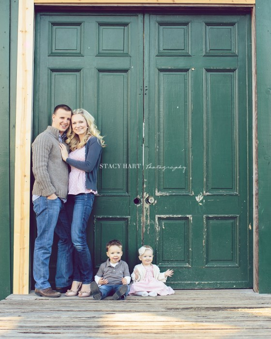 Heather and her family in front of the barn