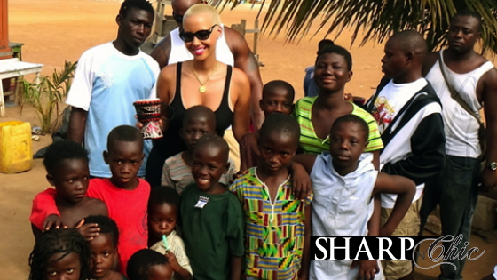 amber rose in ghana posing with children