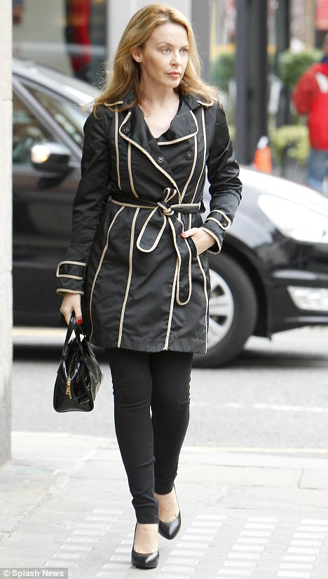 kylie in black coat middleton