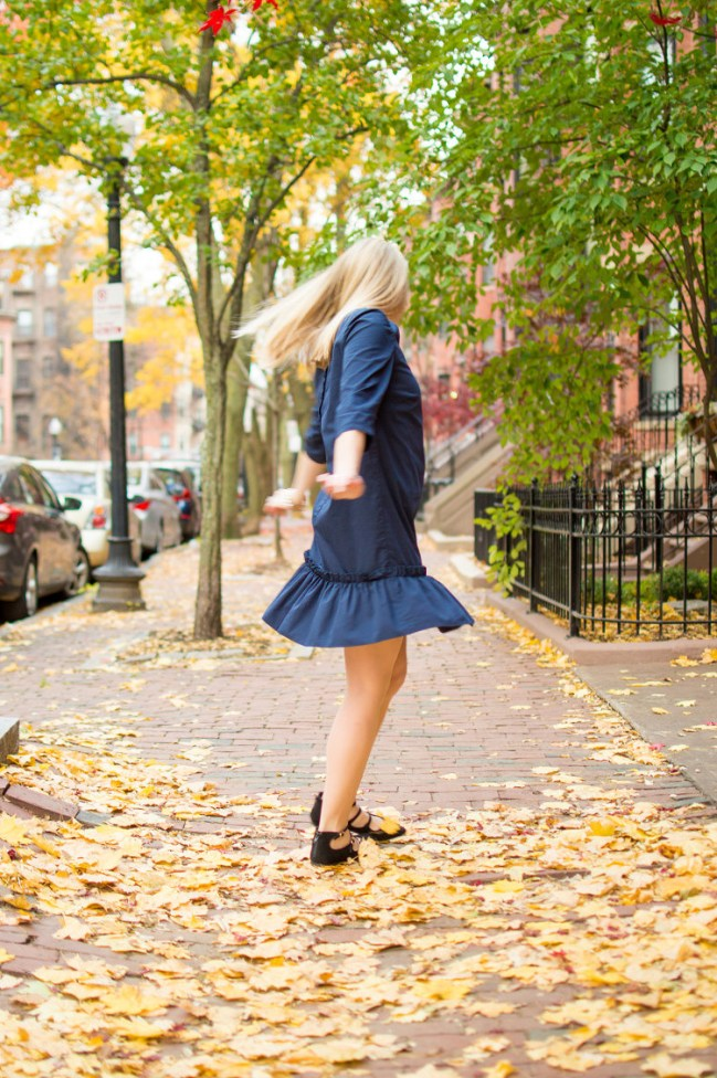 navy drop waist dress twirling photo
