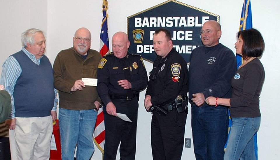 BARS and East Dennis Oyster Farm present checks to Barnstable and Dennis Police