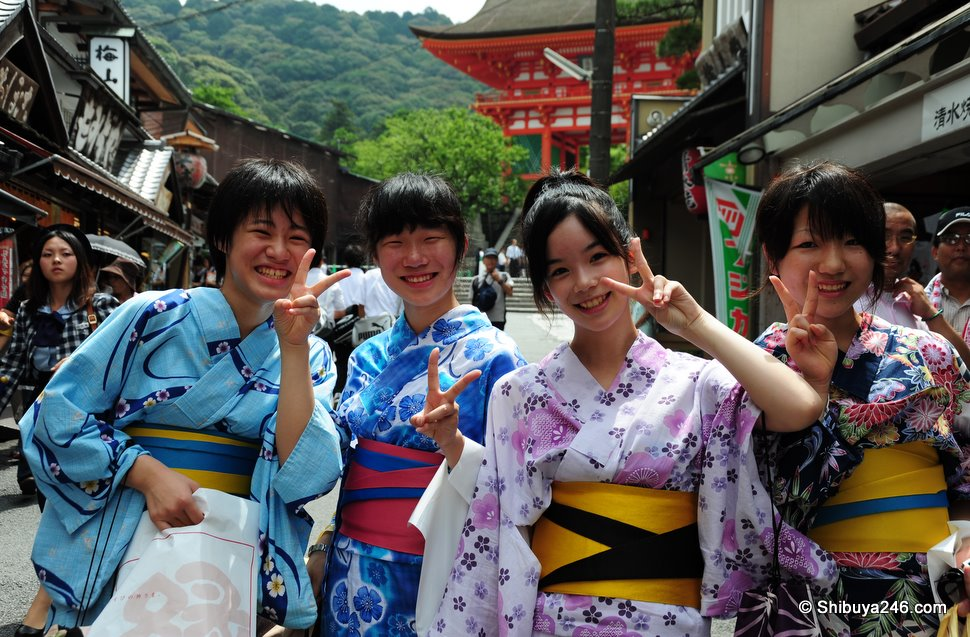Peace out Japan. Four ladies out for the day in their Yukata having just toured around the Temple grounds
