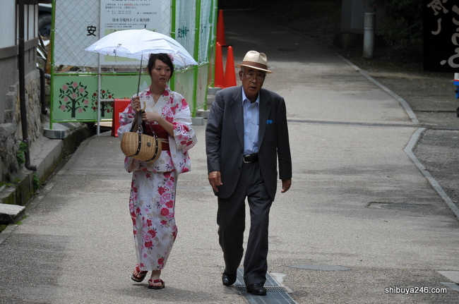 This gentleman out for a stroll with his well dressed lady