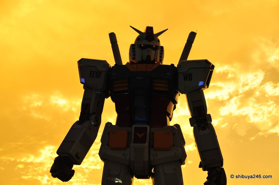 Gundam steps out of the fireball behind him to take on the next battle