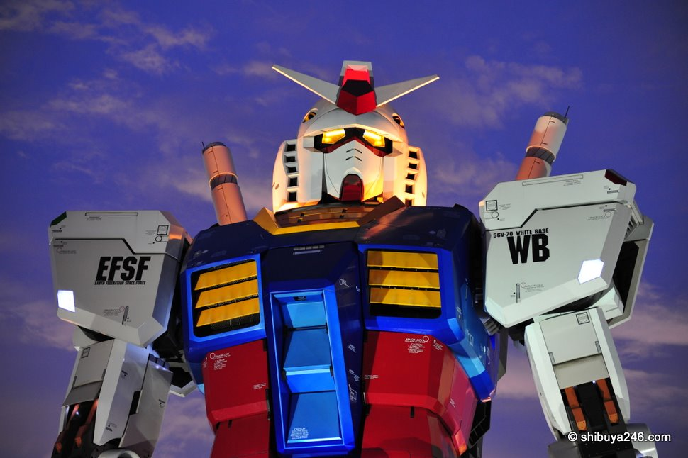 The blue sky highlights Gundam's blue body armour