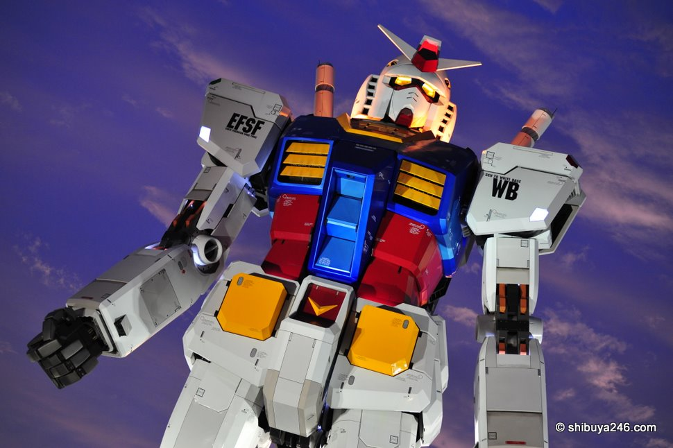 Gundam steps out and almost treads on us