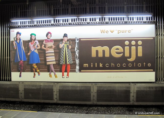 The Meiji Chocolate poster at the station