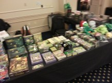 Blurry picture of games, books, and assorted paraphernalia.
