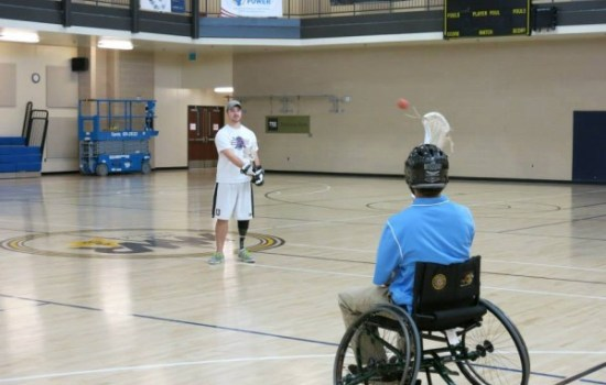 Tyler Steinhardt and Calvin Todd have a catch as Tyler learns to play in a wheelchair.