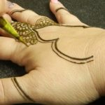 Applying henna paste