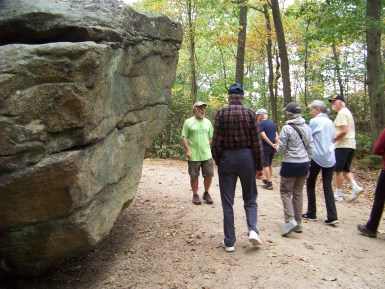 Interpretive trail guide Mike G. leads group past glacial rock