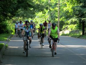Staying cool, cyclists on the way to Lake Quonnipaug on a Shoreline Greenway Trail's First Saturday Bike and Hike, July 6