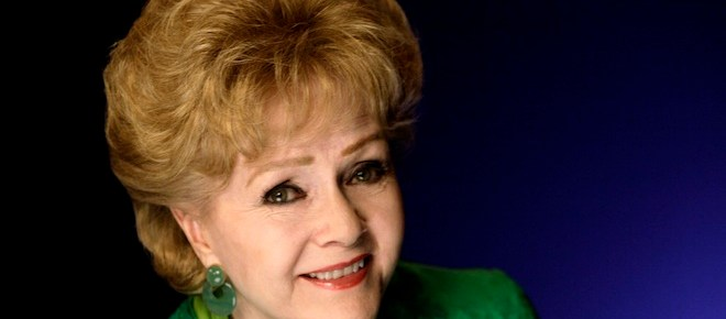 FILE - This Oct. 14, 2011 file photo shows actress Debbie Reynolds posing for a portrait in New York.  Reynolds publicist said Wednesday Oct. 10, 2012 that the actress-singer had to be hospitalized for an adverse reaction to a medication and was canceling several upcoming performances.(AP Photo/Richard Drew, file)