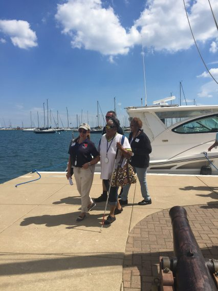 Chicago yacht club volunteer escorting participants from The Chicago Lighthouse to the boats.