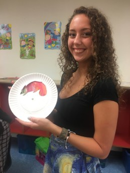 Senior Kylie Mulnix holds up an example of the craft made at the SHS Art Council station.