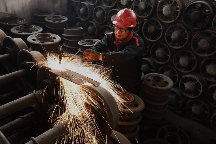 China produces as much steel as the rest of the world combined, but as its growth slows, the excess steel that Chinese industry doesn't need is washing up overseas. Above, a factory worker at a steel products plant in Huaibei, China.