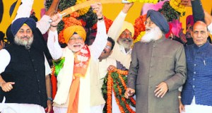 BJP's PM nominee Narendra Modi is flanked by SAD chief Sukhbir Singh Badal (L) and Punjab CM Parkash Singh Badal at a rally in Jagraon. BJP chief Rajnath Singh is on extreme right.